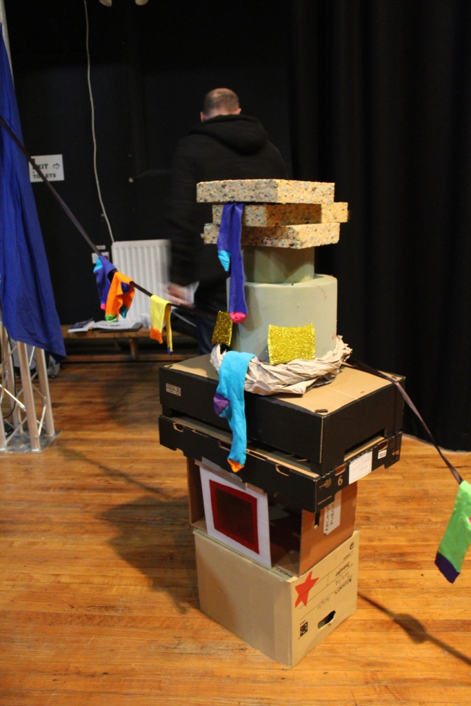A tower of cardboard boxes and sponge blocks